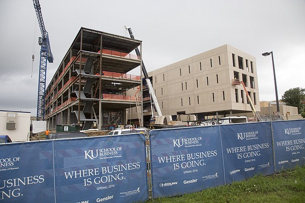 Pictured in June 2015, Capitol Federal Hall, the new KU School of Business building, is going up on Naismith Drive across from Allen Fieldhouse. Construction is slated for completion in spring 2016, and the 166,500-square-foot building will open for classes by fall. The total project cost is $70.5 million, with the $60.5 million construction cost coming from private funds.