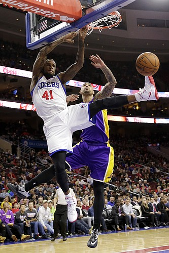 e2dd88df327 Philadelphia 76ers' Thomas Robinson, left, dunks past Los Angeles Lakers' Robert  Sacre