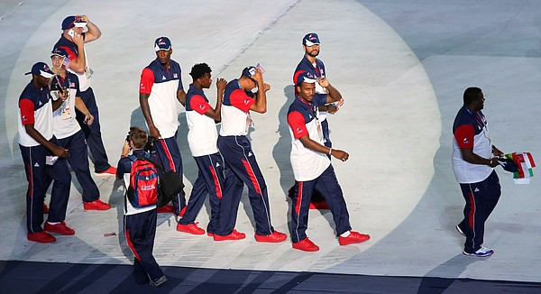 The spotlight hits members of the Team USA basketball team enter Gwangju Universiade Main Stadium during the opening ceremony of the 28th World University Games July 3 in Gwangju, South Korea.