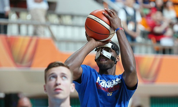 Kansas freshman forward Carlton Bragg warms up wearing a mask to protect his broken nose during Team USA warm ups at Dongkang College Gymnasium.  The team was preparing for a game against Turkey Saturday, July 4 in Gwangju, South Korea.