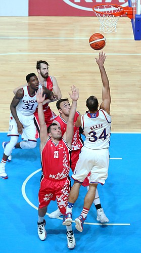 Kansas forward Perry Ellis puts up a shoot over Turkey defenders in a Team USA 66-57 win against Turkey Saturday, July 4, in Gwangju, South Korea..