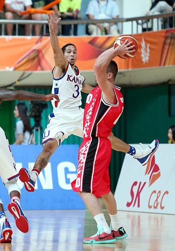 Kansas guard Nic Moore (3) defends against Turkey guard Tugberk Gedikli (10) in a Team USA 66-57 win against Turkey Saturday, July 4, in Gwangju, South Korea..