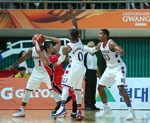 Kansas guards Wayne Selden Jr., Frank Mason III (0) and Landen Lucas triple-team Turkey guard Firat Toz (4) in a Team USA 66-57 win against Turkey Saturday, July 4, in Gwangju, South Korea..