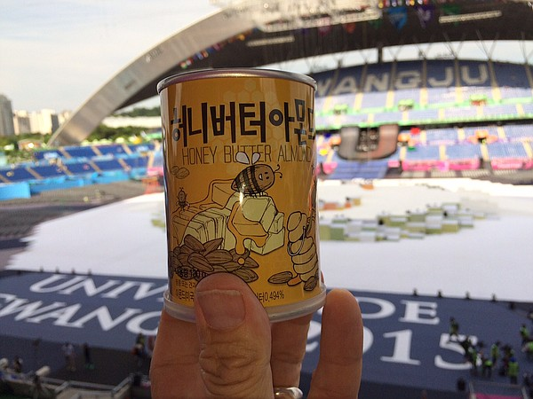 Can of almonds against backdrop of Gwangju Main Stadium, site of the opening ceremonies of the 2015 World University Games.
