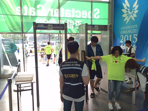 Spectator security gates into venues also monitor people's temperatures.