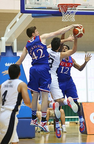 Kansas center Hunter Mickelson (42) blocks a shot by Chilean guard Fernando Schuler (13) with Team USA guard Julian DeBose (12) also defending in a Team USA game against Chile Tuesday, July 7, at the World University Games in South Korea.