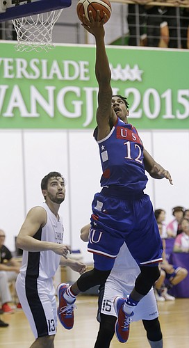 Team USA guard Julian DeBose (12) drives for a score in a 106-41 Team USA win against Chile Tuesday, July 7, at the World University Games in South Korea.