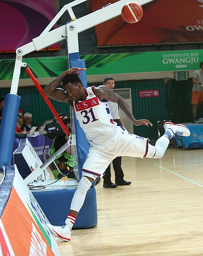 Kansas forward Jamari Traylor attempts to save a ball from going out of bounds in a Team USA 66-65 win against Serbia Wednesday, July 8, at the World University Games in South Korea.