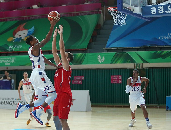 Team USA guard Julian DeBose (12) drives to the basket for two of his team-leading 18 in a Team USA game against Switzerland Thursday, July 9, at the World University Games in South Korea.