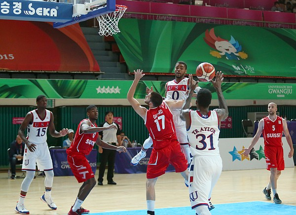 Kansas guard Frank Mason III (0) passes to Jamari Traylor who scored on the play during a Team USA 96-57 win over Switzerland Thursday, July 9, at the World University Games in South Korea..