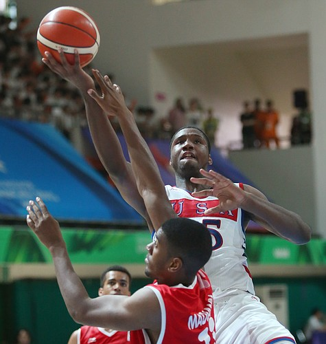 Kansas forward Carlton Bragg (15) drives to the basket for two of his 9 points in a Team USA 96-57 win over Switzerland Thursday, July 9, at the World University Games in South Korea.