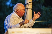 Bob Foster conducts the Lawrence City Band during their concert at South Park on Wednesday, July 8, 2015.