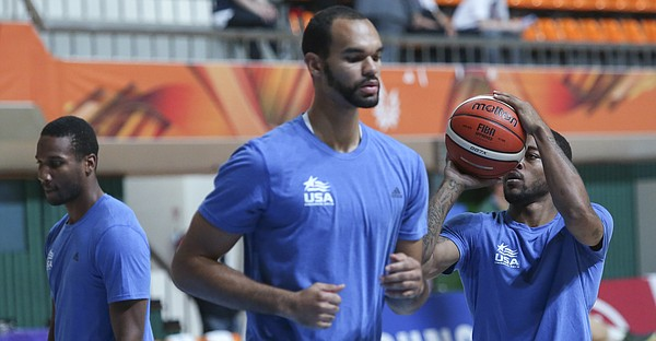 Team USA players from left, Wayne Selden Jr., Perry Ellis and Frank Mason III warm-up before a Team USA quarter-final game against Lithuania Saturday, July 11, at the World University Games in Gwangju, South Korea.