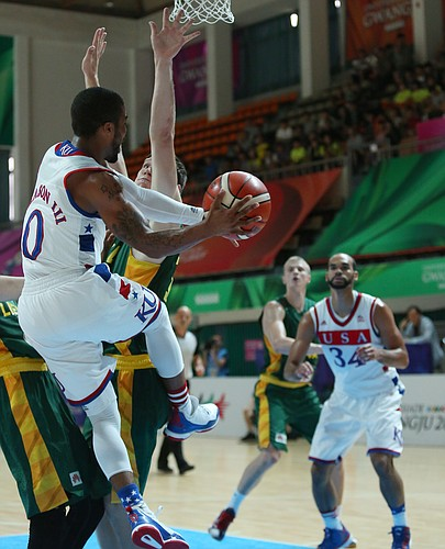 Kansas guard Frank Mason III (0) passes to Perry Ellis, (34) right from beneath the basket in a Team USA quarter-final game against Lithuania Saturday, July 11, at the World University Games in Gwangju, South Korea.