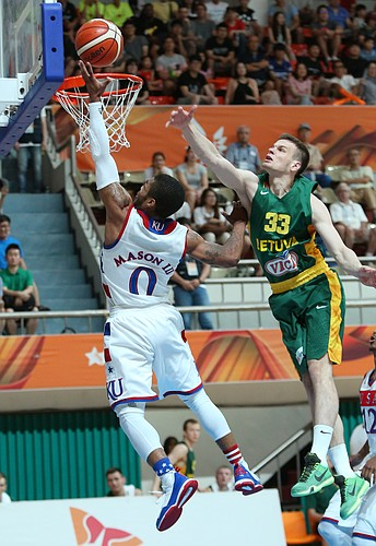 Kansas guard Frank Mason III (0) drives to the basket past Lithuania forward Tomas Dimsa (33) in a Team USA quarter-final win against Lithuania Saturday, July 11, at the World University Games in Gwangju, South Korea.