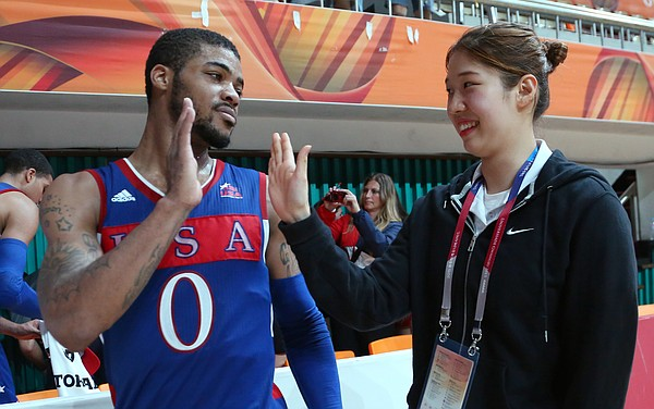 Kansas guard Frank Mason III (0) high-fives a volunteer at the Dongkang College Gymnasium after a Team USA 78-68 semifinal victory over Russia on Sunday, July 12, 2015, at the World University Games in South Korea.