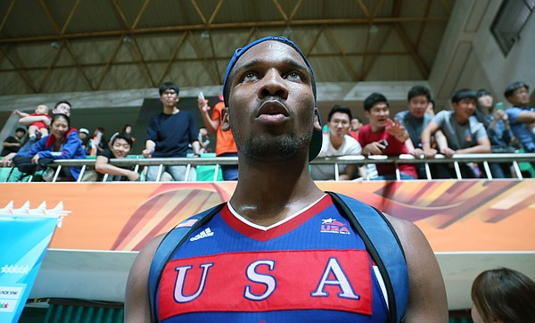 Fans shout and reach out to Kansas guard Wayne Selden Jr. after Team USA's 78-68 semifinal victory over Russia on Sunday, July 12, 2015, at the World University Games in South Korea. Selden scored 22 points in the win.