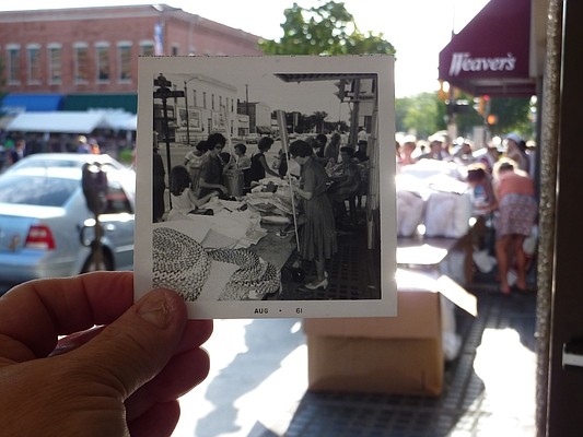 An old photo of Weaver's Department Store during the 1961 Downtown Lawrence Sidewalk Bazaar is pictured in front of Weaver's during the Downtown Lawrence Sidewalk Sale in 2012.