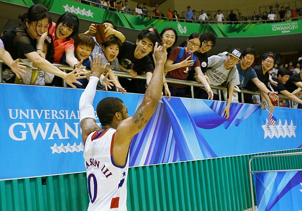 Kansas guard Frank Mason III (0) runs past celebrating fans after a Team USA double-overtime win against Germany Monday, July 13, at the World University Games in South Korea.