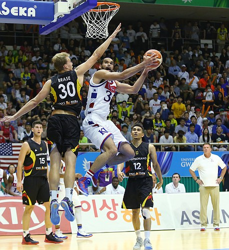 Kansas forward Perry Ellis drives to the basket in a Team USA double-overtime win against Germany Monday, July 13, at the World University Games in South Korea.