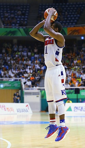 Kansas guard Wayne Selden Jr. (1) hits a three-point basket that put Team USA ahead 80-77 in a second overtime, and was the deciding basket in a double-overtime 84-77 win against Germany Monday, July 13, at the World University Games in South Korea.
