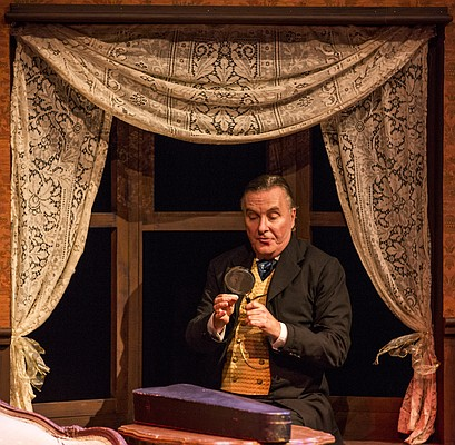 "Sherlock Holmes, portrayed by Robert Brand, uses his trusty magnifying glass to inspect a clue during a dress rehearsal for Kansas Repertory Theatre's production of ""Sherlock's Last Case"" on Tuesday evening at Crafton-Preyer Theatre in Murphy Hall."