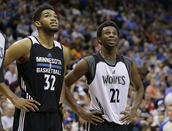 Minnesota Timberwolves forward Andrew Wiggins (22) and center Karl-Anthony Towns (32) watch a free-throw during an NBA basketball scrimmage in Minneapolis, Wednesday, July 8, 2015. (AP Photo/Ann Heisenfelt)