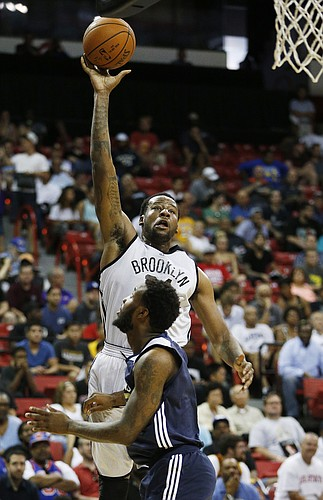 Brooklyn Nets' Cliff Alexander goes up for a shot against New Orleans Pelicans' Victor Rudd during the first half of an NBA summer league basketball game Monday, July 13, 2015, in Las Vegas. (AP Photo/John Locher)