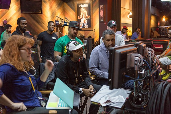 """Spike Lee, center, and Kevin Willmott, right, on the set of """"Chiraq."""""""