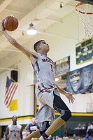 Highly sought recruit Michael Porter soars for a dunk during the KC Hardwood Classic on Friday at Shawnee Mission South High School in Overland Park.