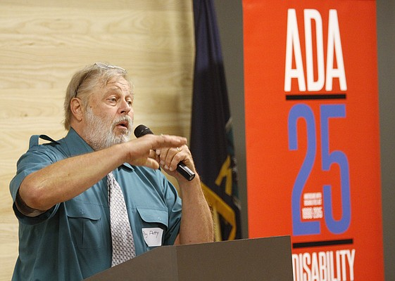Ray Petty, Kansas coordinator of the Great Plains ADA Center, speaks at an Americans with Disabilities Act 25th Anniversary Celebration on Saturday at the Lawrence Public Library.