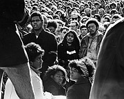 Black and white youths gather for a rally in front of Strong Hall at Kansas University in this file photo from December 1970. Some participants carried posters of Rick Dowdell, who was killed that July.