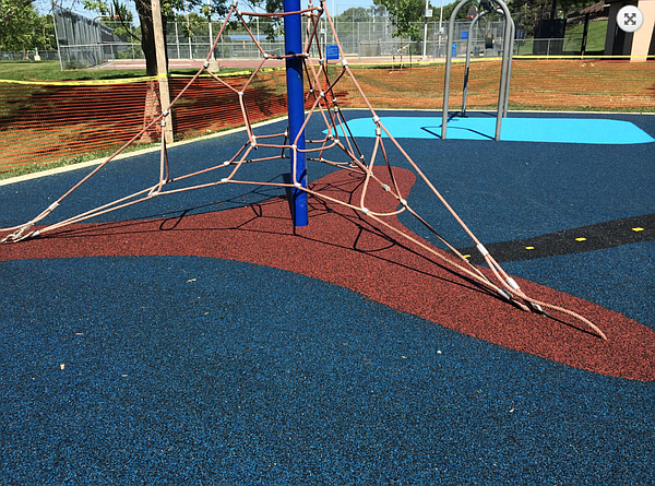 An example of a rubberized playground surface, as shown on the Eco Turf web site.