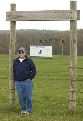 Former Kansas University cross country coach Bob Timmons poses near the gate to Rim Rock Farm in this file photo from 2005.
