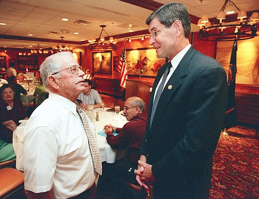Former Kansas University track and cross country coach Bob Timmons, left, enjoys a few moments of conversation with Rep. Jim Ryun, R-Kan., during a Lawrence Chamber of Commerce Luncheon in this 2001 file photo.