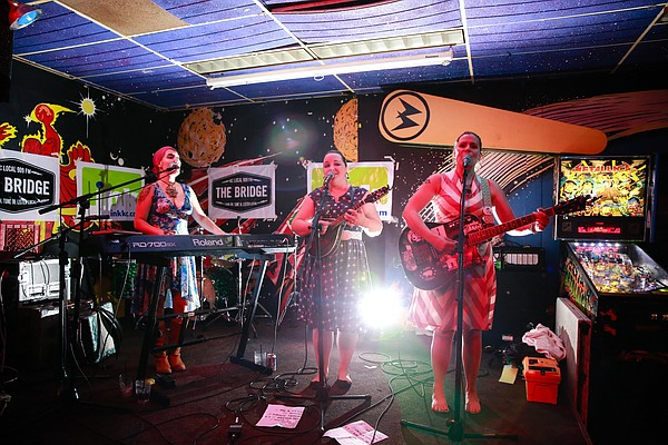 From left, Ashley Zeigenbein (keyboard/accordion), Monica Greenwood (mandolin) and Brianne Grimmer (guitar) of the band Sugar Britches perform June 26 at the Replay Lounge. The sassy country/bluegrass band, which also features bassist Kahlen Ryba (not pictured), formed in March and quickly established a fan base.