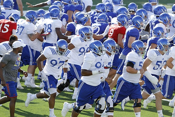 Kansas football players participate in a KU football practice in front of KU fans as part of fan appreciation activities Saturday August 8, 2015.