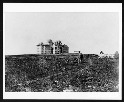 The Kansas University campus pictured in the 1870s, after the construction of University Hall, KU's second building. University Hall, which opened publicly in 1872 even though it wasn't quite finished, according to KUhistory.com, is better known now as Old Fraser.