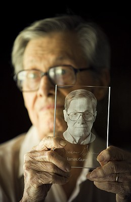 Lawrence science fiction writer and Kansas University professor emeritus James Gunn is pictured with a miniature version of a translucent award featuring his own likeness that will be on display at the Science Fiction Museum and Hall of Fame in Seattle. Gunn, who is the author of 42 published science fiction novels and is working on his 43rd, was inducted into the Science Fiction Hall of Fame this summer.