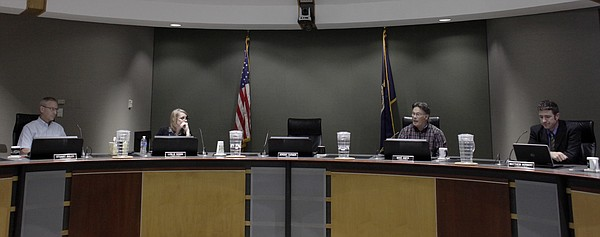 The Lawrence city commissioners from left, Stuart Boley, vice mayor Leslie Soden, Mike Amyx and Matthew Herbert  hold a special meeting Friday, Aug. 14, to take formal action on the resignation of Mayor Jeremy Farmer and receive public comments on filling the vacancy and filling the position of Mayor.