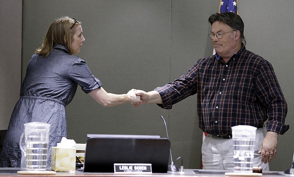Vice Mayor Leslie Soden and City Commissioner Mike Amyx greet each other before a special commission meeting Friday, Aug. 14, 2015, to take formal action on the resignation of Mayor Jeremy Farmer and receive public comments on filling the vacancy and filling the position of mayor.