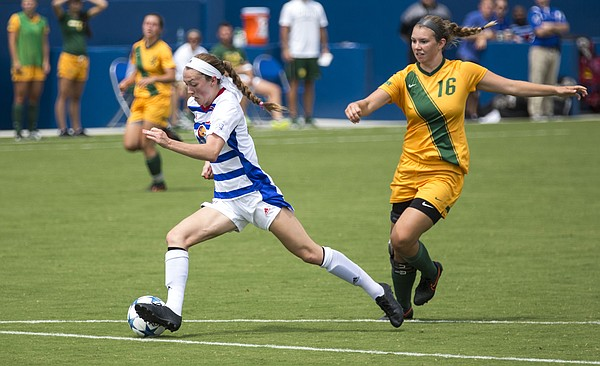 Kansas freshman midfielder Grace Hagan makes a move in the open field to shake North Dakota State junior midfielder Natalie Fenske (16) during their exhibition soccer match Sunday at Rock Chalk Park. The Jayhawks and the Bison played to a 2-2 tie. The Jayhawks start the season on the road with four straight away games beginning in Lincoln, Neb. against Nebraska on Friday, Aug. 21. Kansas then returns to Rock Chalk Park to host Santa Clara in its home opener on Friday, Sept. 4, at 5 p.m.