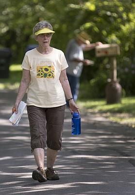 Janet Burnett-Huchingson walks along Elmwood Street just west of Oak Hill Cemetery in East Lawrence on Aug. 13. Burnett-Huchingson has a plan to walk every street in Lawrence.