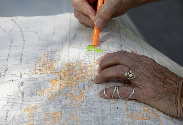 Janet Burnett-Huchingson, of Lawrence, tracks her walking progress on a city map, highlighting in orange the routes she's already completed.