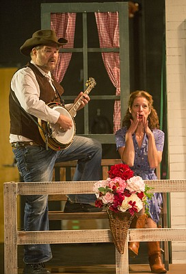 "Ric Averill and Kirsten Paludan are pictured on the set of the Lawrence Arts Center's upcoming ""Cowboy Cabaret.""  The honky tonk variety show, slated for Saturday, Aug. 22, at the Arts Center, is the original creation of Paludan and her Starhaven Rounders band, who will host and perform as the show's in-house band. Averill and his wife, Jeanne, will also perform in the show."