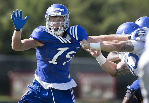 Kansas University tight end Jace Sternberger (19) pushes a defensive lineman away during practice on Friday, Aug. 21, 2015, at Memorial Stadium.