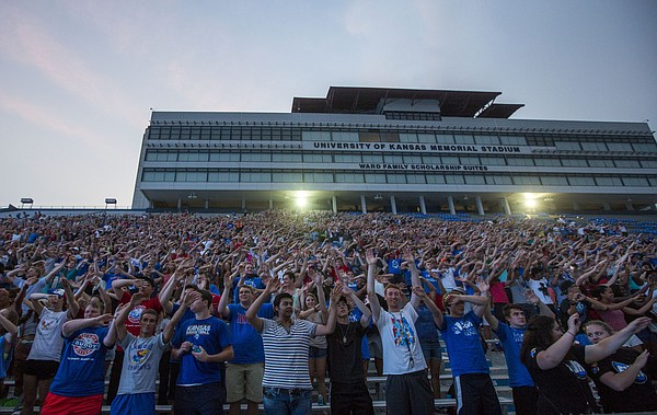 Incoming freshman learn how to wave the wheat  at KU Traditions Night Saturday evening at Memorial Stadium. The annual event held before the start of each new school year aims to teach incoming freshmen about the traditions that make KU unique.