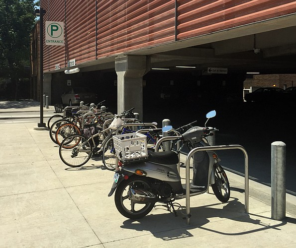 A bike corral is pictured Tuesday, Aug. 25, 2015, in front of the parking garage near the Lawrence Public Library, 707 Vermont St.