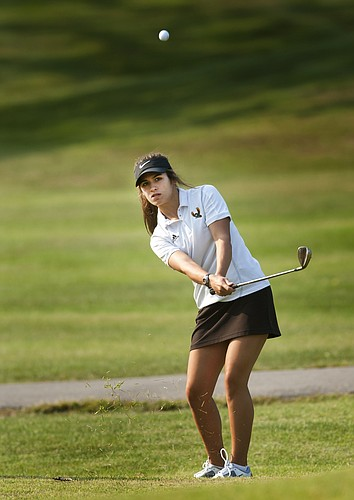 Free State High's Anne Goebel chips onto a green during the Mill Valley Invitational on Wednesday at Alvamar.