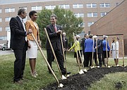 From left, Douglas A. Girod, M.D., executive vice chancellor of KU Medical Center, KU Chancellor Bernadette Gray-Little and Kansas Governor Sam Brownback visit Aug. 27, 2015, during a ceremonial groundbreaking at the University of Kansas Medical Center for its $75 million Health Education Building, which will serve as the primary teaching facility for the KU schools of Medicine, Nursing and Health Professions.